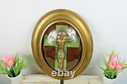 Antique French crucifix in tiles ceramic behind glass framed wall panel plaque